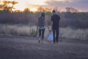 A family walking in nature.