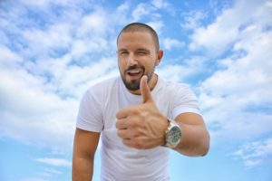 Man showing thumbs up after recommending reliable movers in Florida.