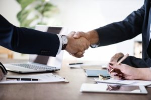 shaking hands during a business deal