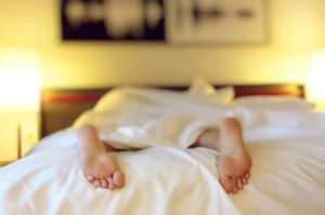 a person sleeping in a bed and trying to prepare for settling down after the move