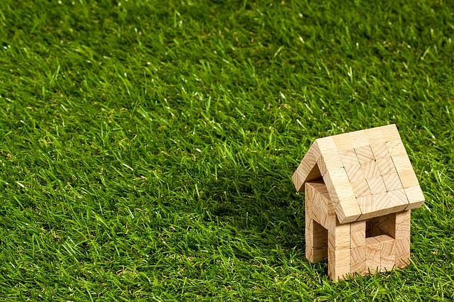 a small wooden house on the grass