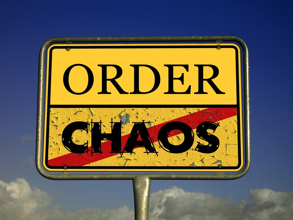A yellow sign with the words ORDER and CHAOS