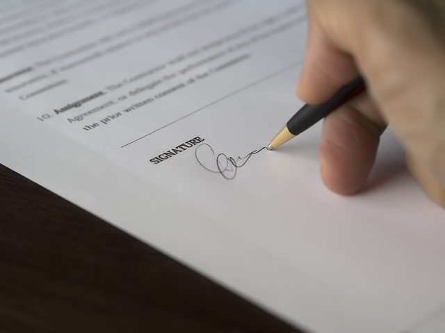 Signing a contract - after you find the best movers.