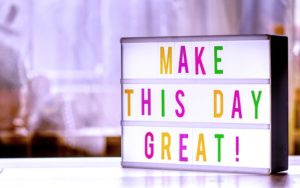 """A sign """"make this day great"""", a great way to organize your belongings for donation"""