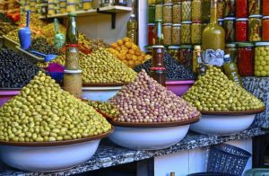 A market stall with spices and fruits in Kuwait.