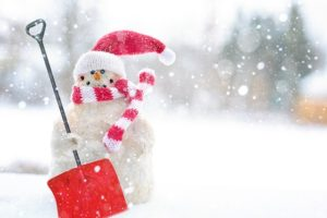 Snowman with a shovel, winter moving