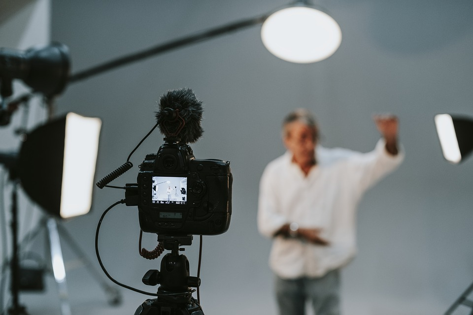 A man in a filming studio.