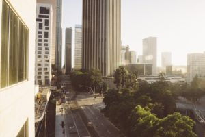 A street in Los Angeles with some tall buildings you will see frequently once your moving to Los Angeles is complete.
