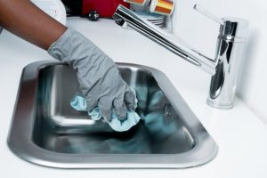 Cleaning the sink.