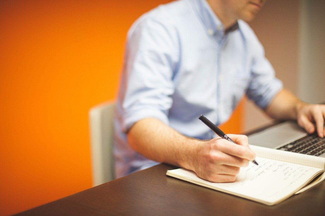 A man working at a desk.