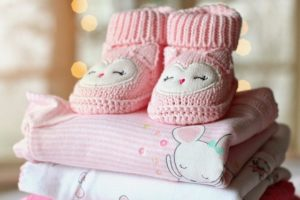 Some baby clothes because one of the best downsizing tips is getting rid of the clothes for babies.