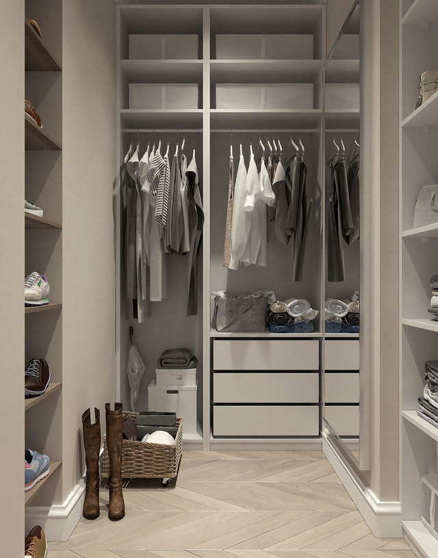 Create more space in your walk in closet by organizing it.