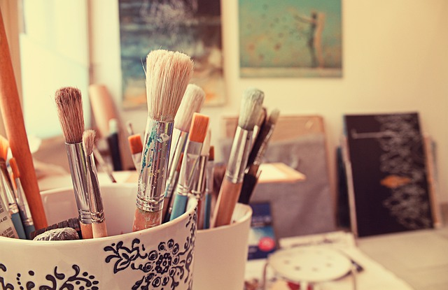 Brushes and paintings - Learn how to move your Santa Fe - based art studio.