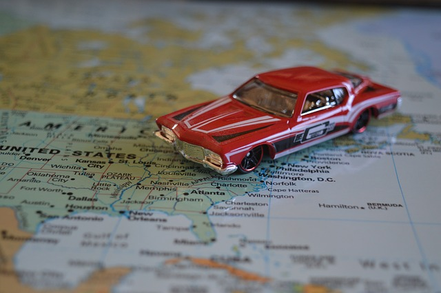 A model car on a map during cross country moving