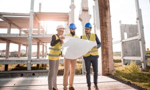Architects obserivng the plan at a building site.