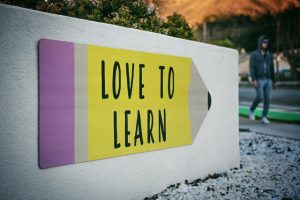 Sign that says 'love to learn' in college campus.