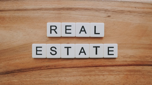 "Scrabble tiles arranged to say ""real estate""."