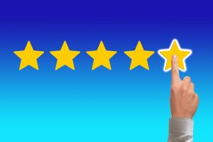 A finger pointing on the five-star review as reviews matters when finding long distance movers in New Jersey.