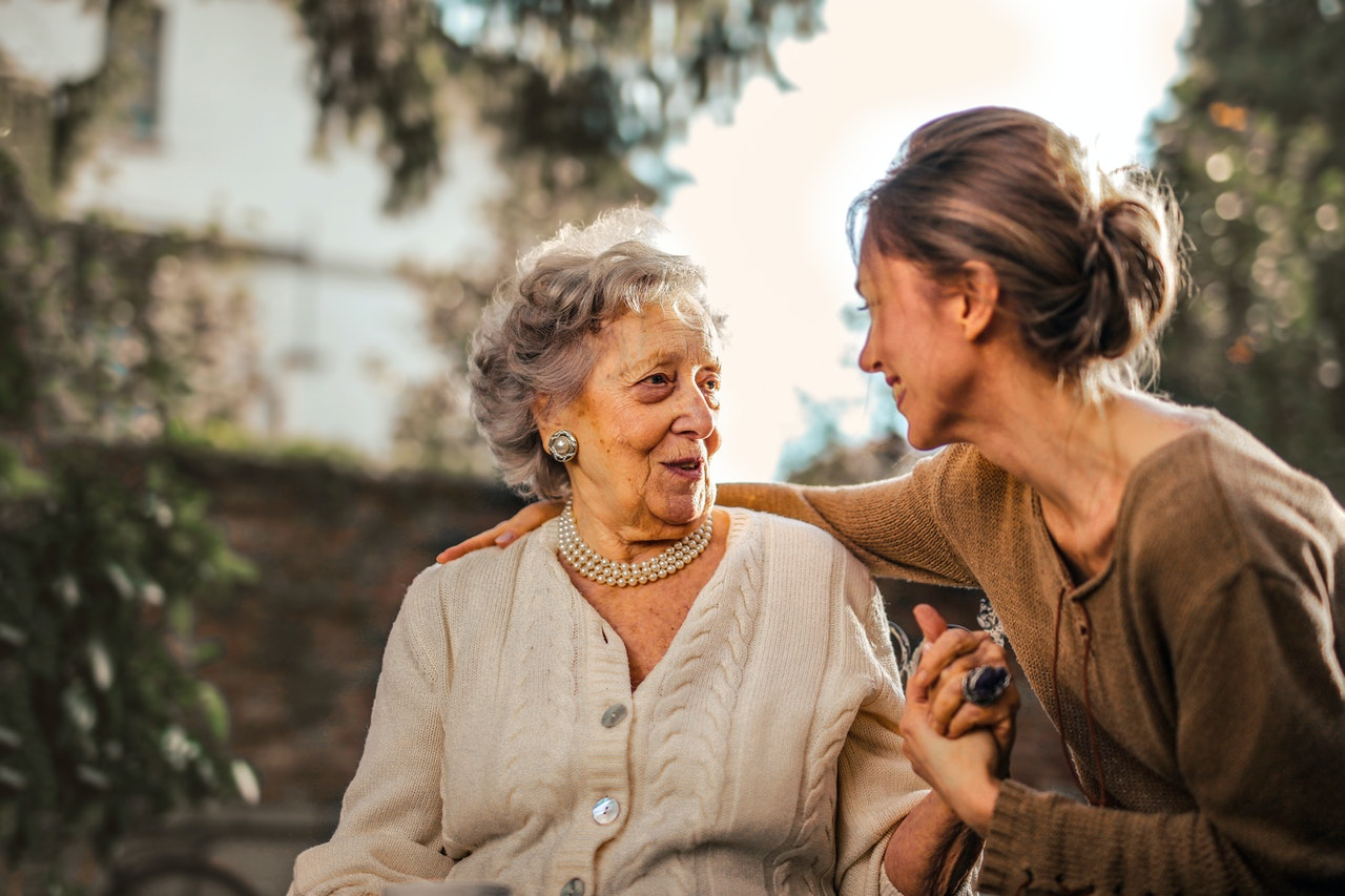 Daughter and elderly mother meetup. Show kindness while helping your elderly parents move.