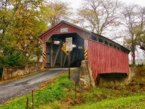 A covered bridge in the forest must be a part of the guide to the most charming boroughs of Pennsylvania.