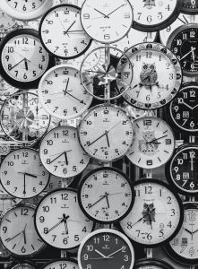 A wall covered in clocks