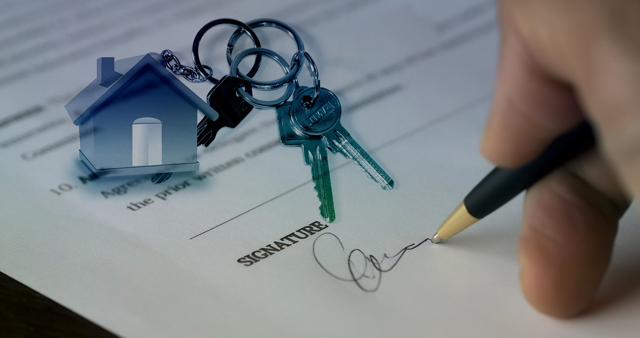 The keys and the contract you get when you find the right property after exploring the housing market in Coconut Creek