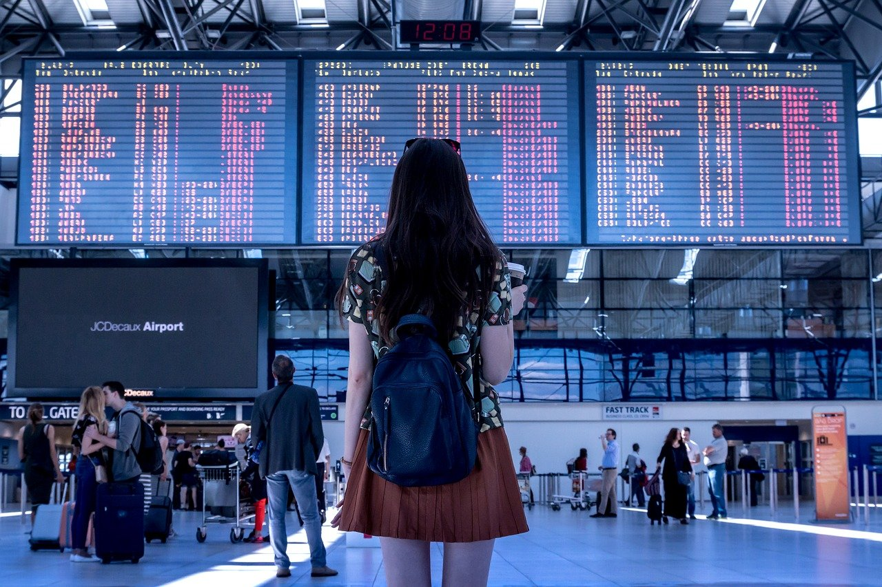 A girl at the airport before leaving the States.