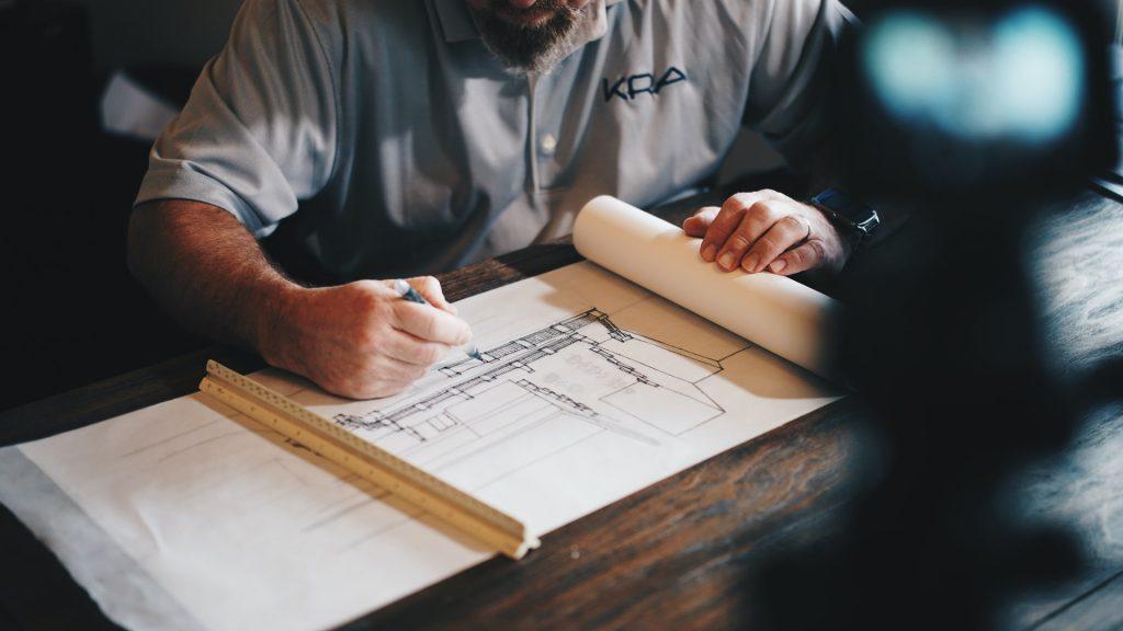man drawing an architect plan