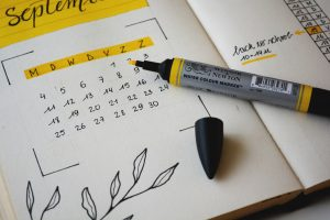 an image of a black marker on notebook with a calendar