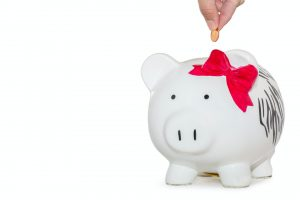 white ceramic piggy bank for saving up to buy home in St Petersburg