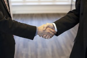 Shaking hands - Find the right professional who will provide you with the specialty moving services your need.