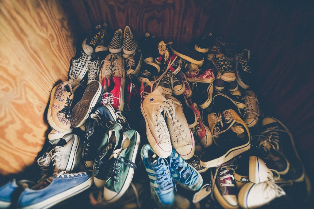 A pile of shoes before packing shoes for storage